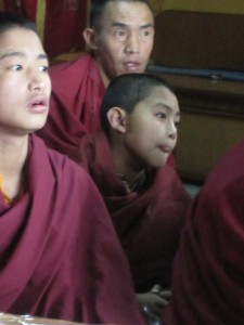 monks listening to rinpoche teac